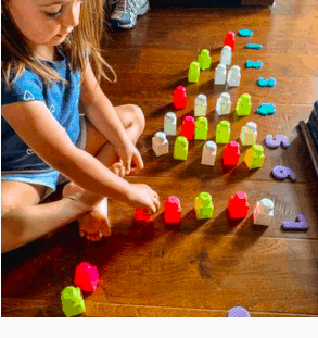 teaching numbers to toddlers as they play with blocks