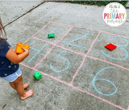 teaching numbers to toddlers in fun ways with dice, chalk, and bean bags